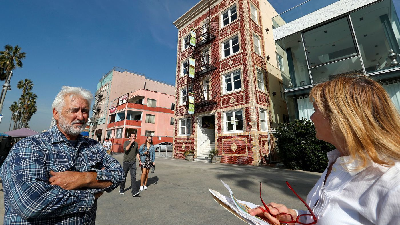 John Okulick and his wife, Marlene, shown on the Venice boardwalk, are among a group of Venice property owners who are suing to dissolve the area's new business improvement district, saying it has failed to deliver services. (Mel Melcon / Los Angeles Times)