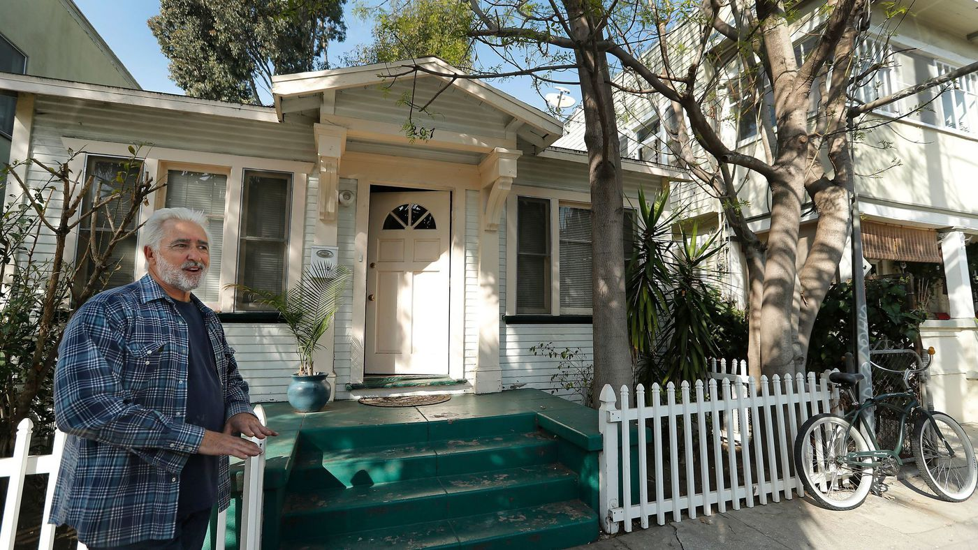 John Okulick stands outside a home located in the Venice Beach Business Improvement District. Its owner is among the plaintiffs suing to dissolve the district. (Mel Melcon / Los Angeles Times)